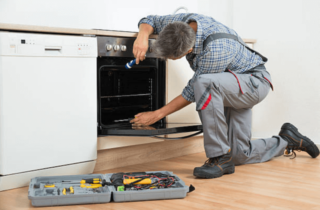 broken dishwasher in a home